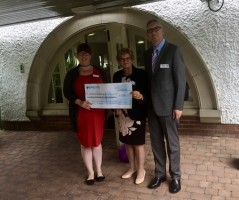 The GM and partner John present the cheque